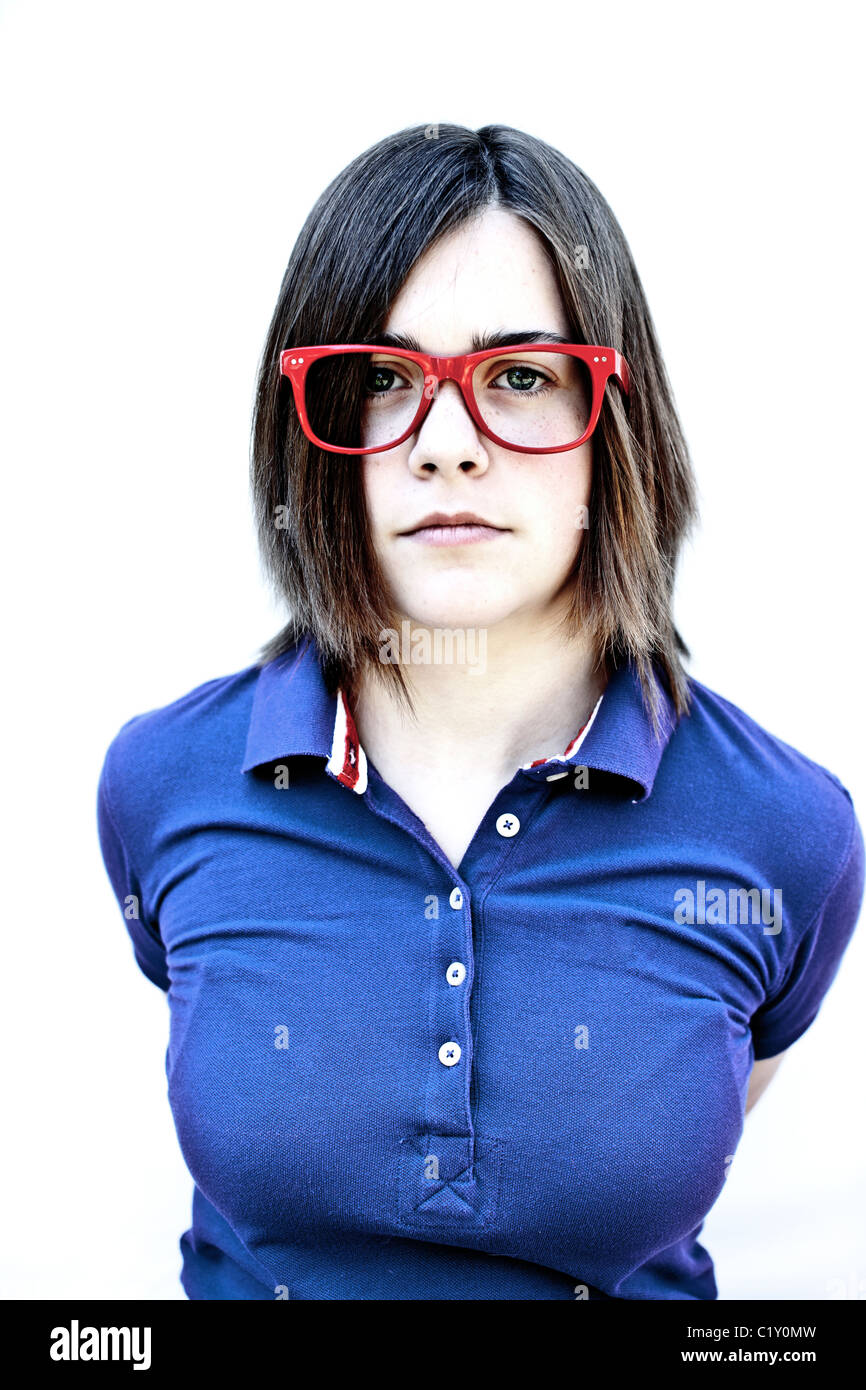 A teenage girl wearing funky red glasses - Stock Image