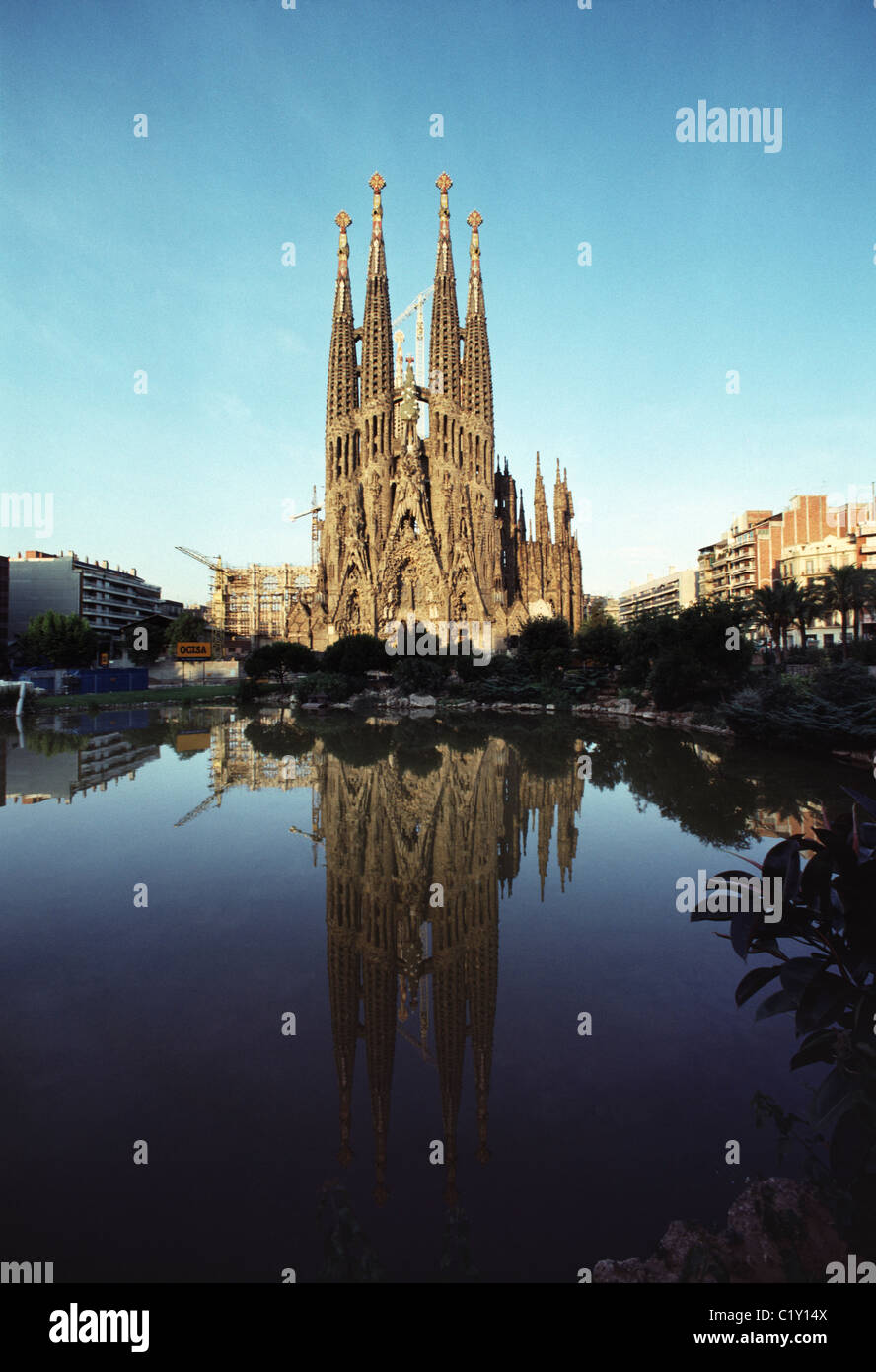 Reflection of Sagrada Familia Cathedral in pond - Stock Image