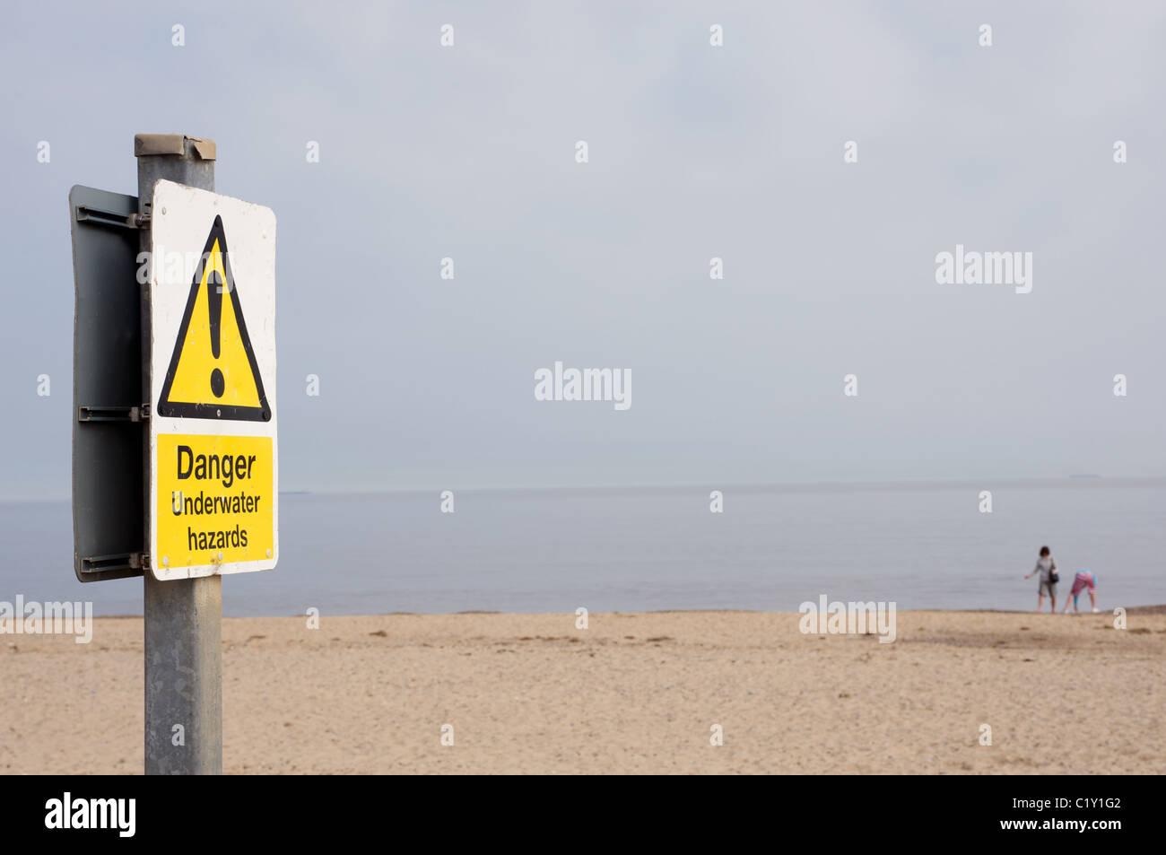 Danger underwater hazards sign, Suffolk, UK. - Stock Image