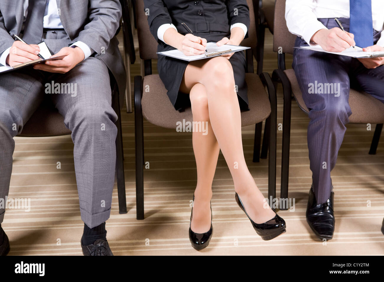 Line of business people making notes or writing business plan - Stock Image