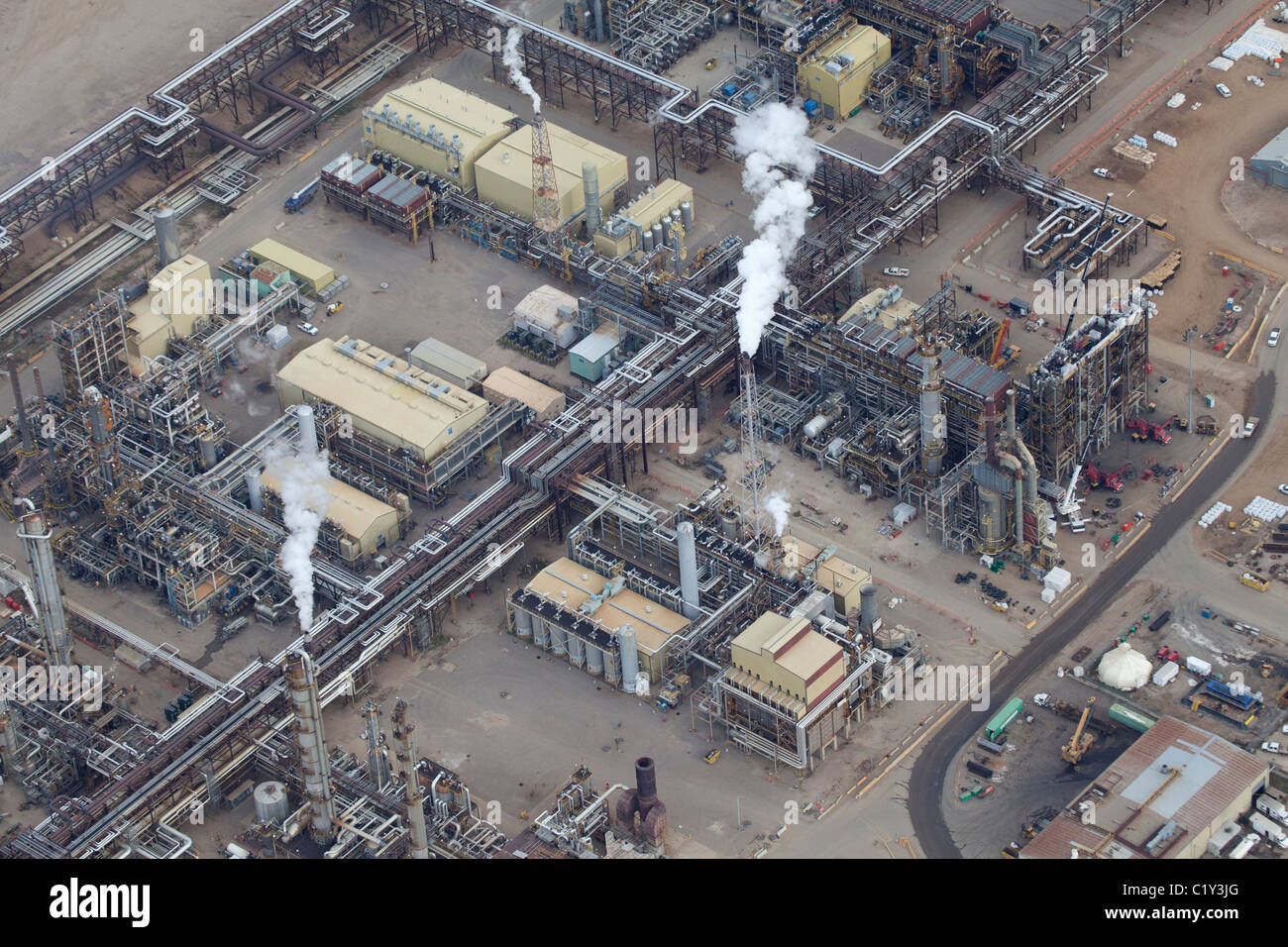 Aerial view of oil refinery with smoke stacks, detail