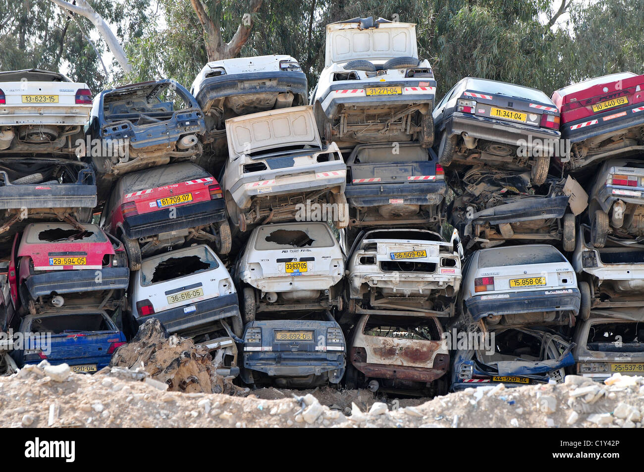 Car scrapyard. Cars piled up in a scrapyard. Photographed in Beer ...