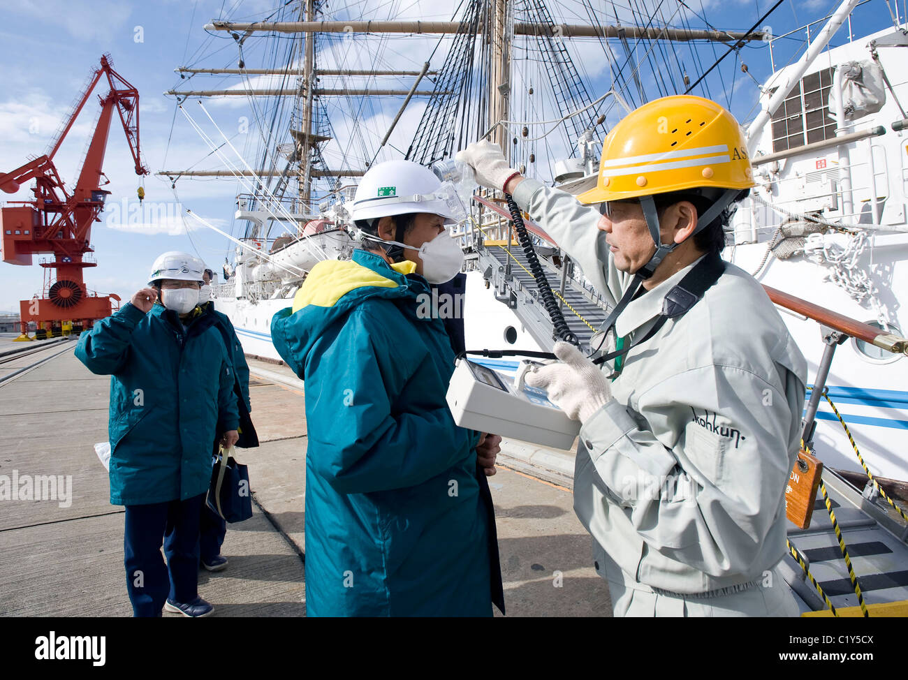 Staff involved with delivering goods to the nuclear power plants are given a radiation check prior to boarding the - Stock Image