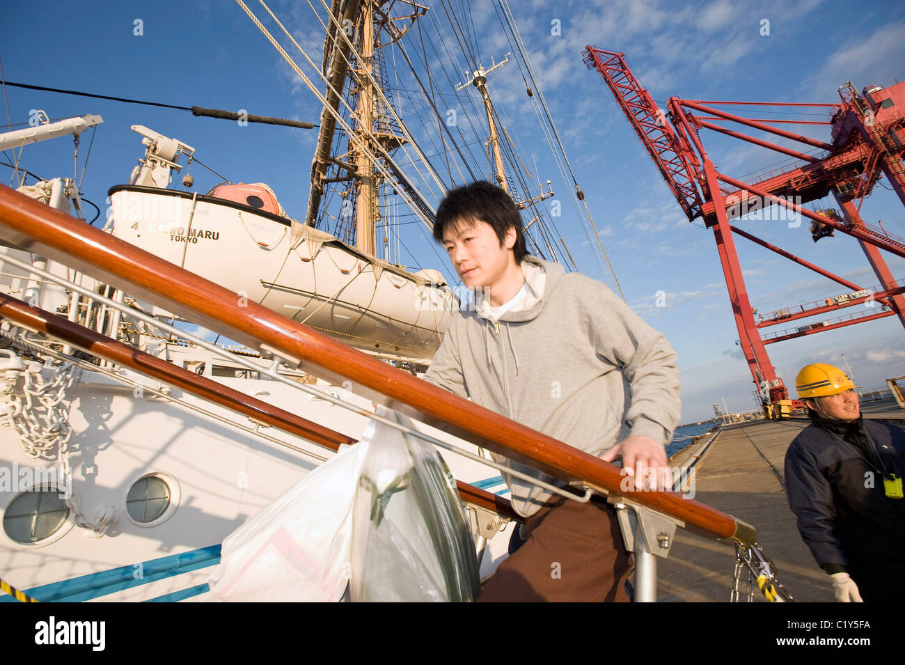 Akira Tamura, a member of the so-called Fukushima 50 boards the Kaiwomaru - Stock Image
