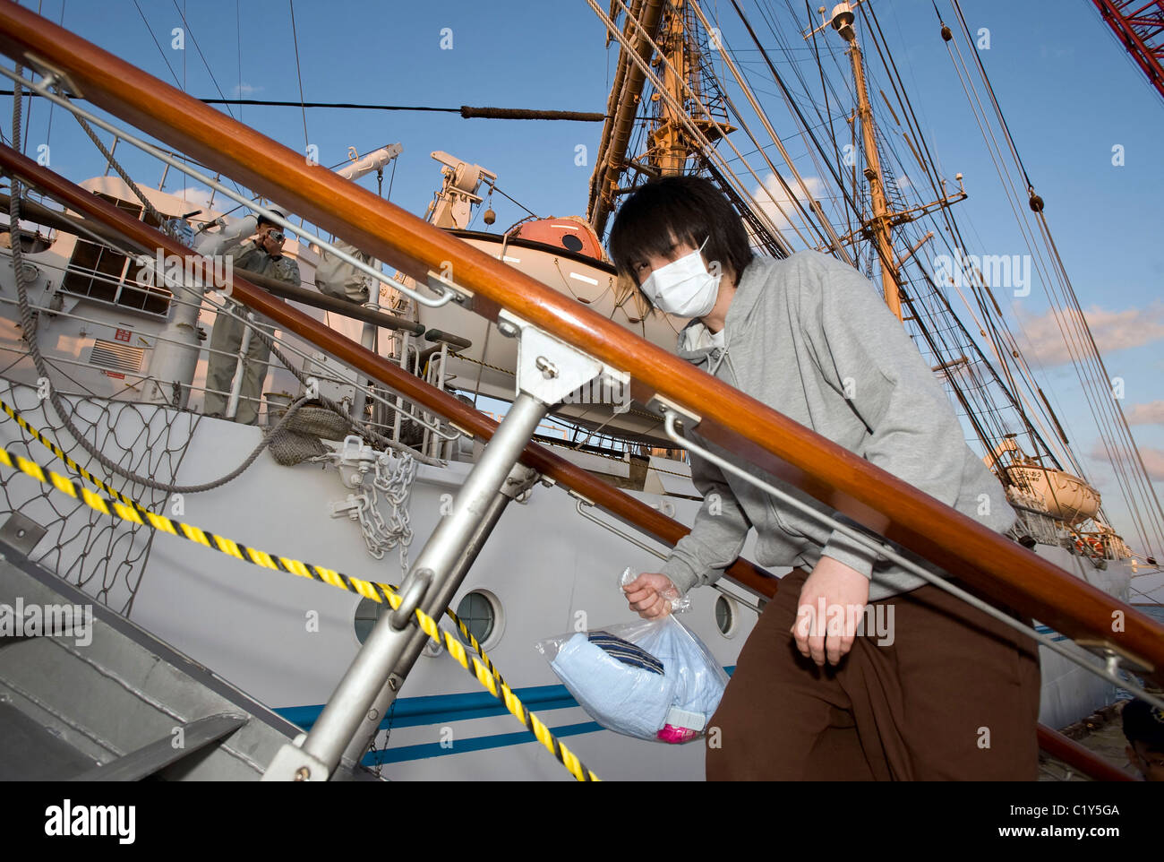 A member of the so-called Fukushima 50 boarding the Kaiwomaru - Stock Image