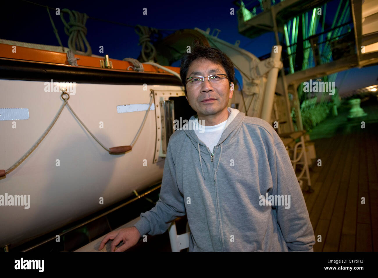 A member of the so-called Fukushima 50 is given poses for a photo - Stock Image