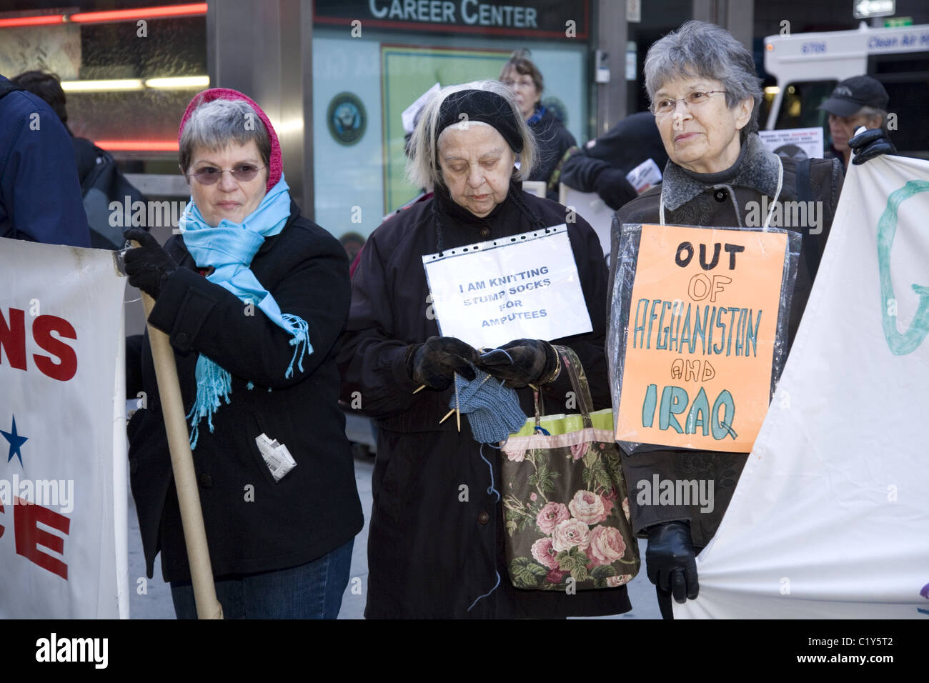 Anti-war demonstrators in front of the midtown armed forces recruiting station in Times Square, NYC - Stock Image