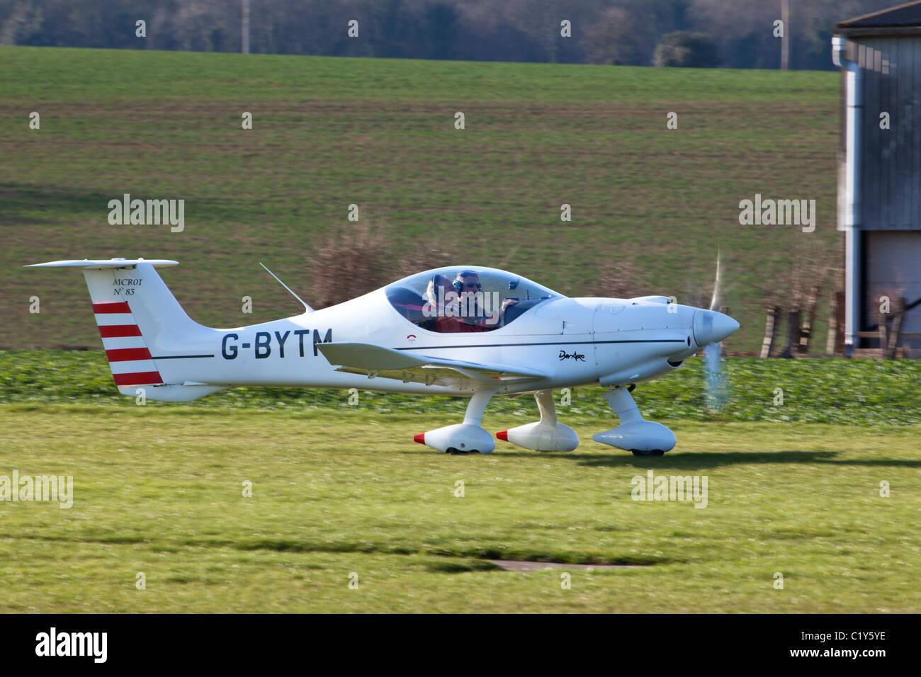 DynAero MCR-01 Banbi G-BYTM taxiing to the runway at Netherthorpe Airfield - Stock Image