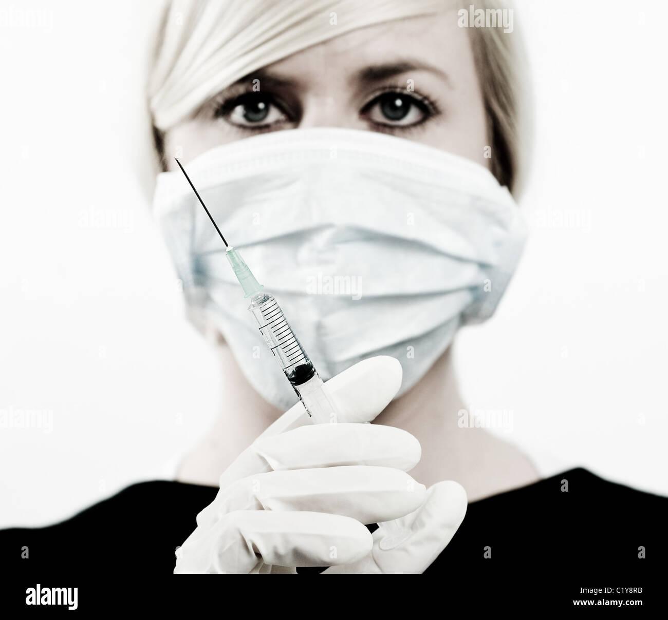 nurse holding syringe - Stock Image