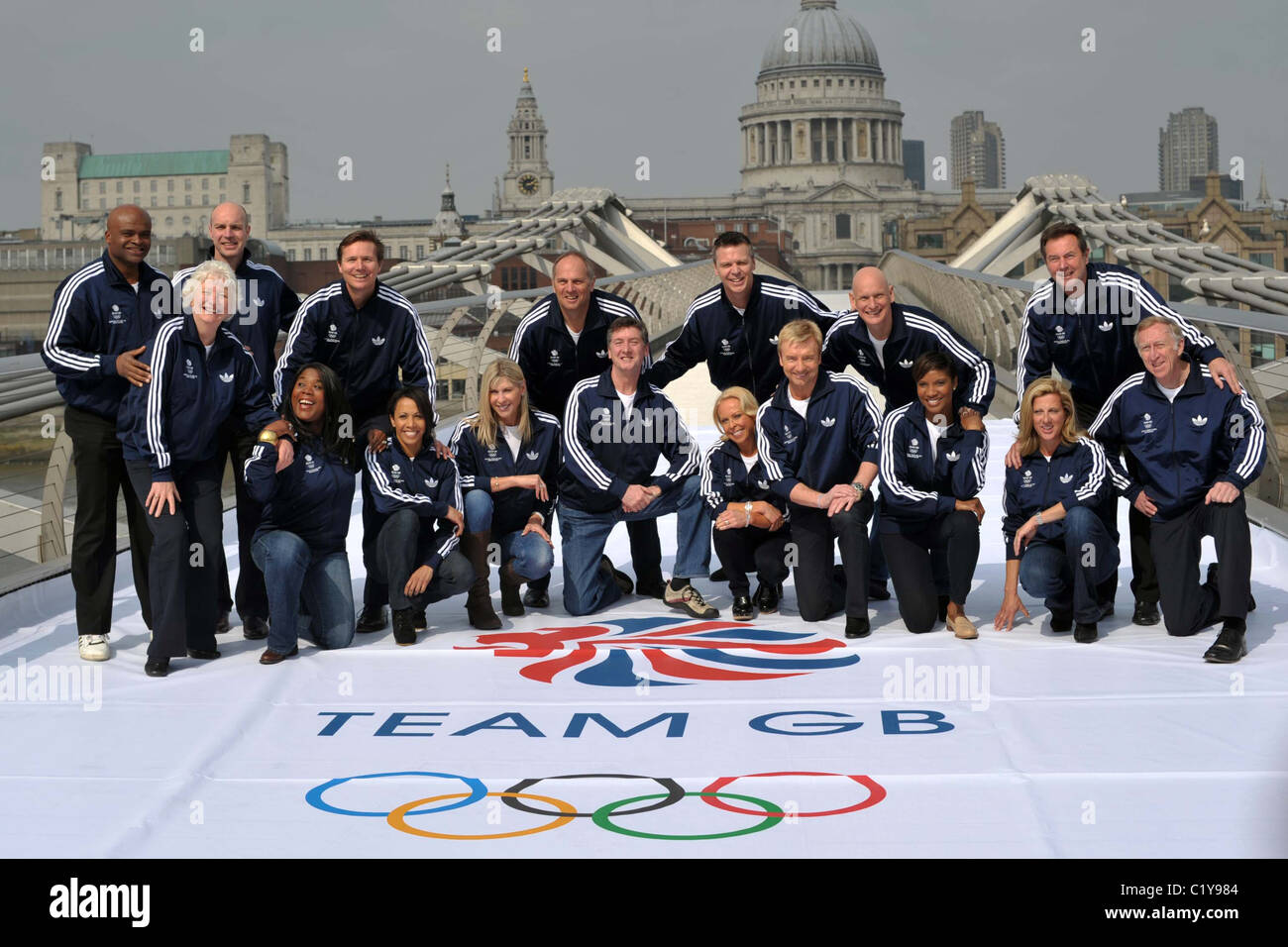 17 of the 27 Official Team GB 2012 Ambassadors pose on the Millenium Bridge in London near the Tate Modern. Southbank. Stock Photo