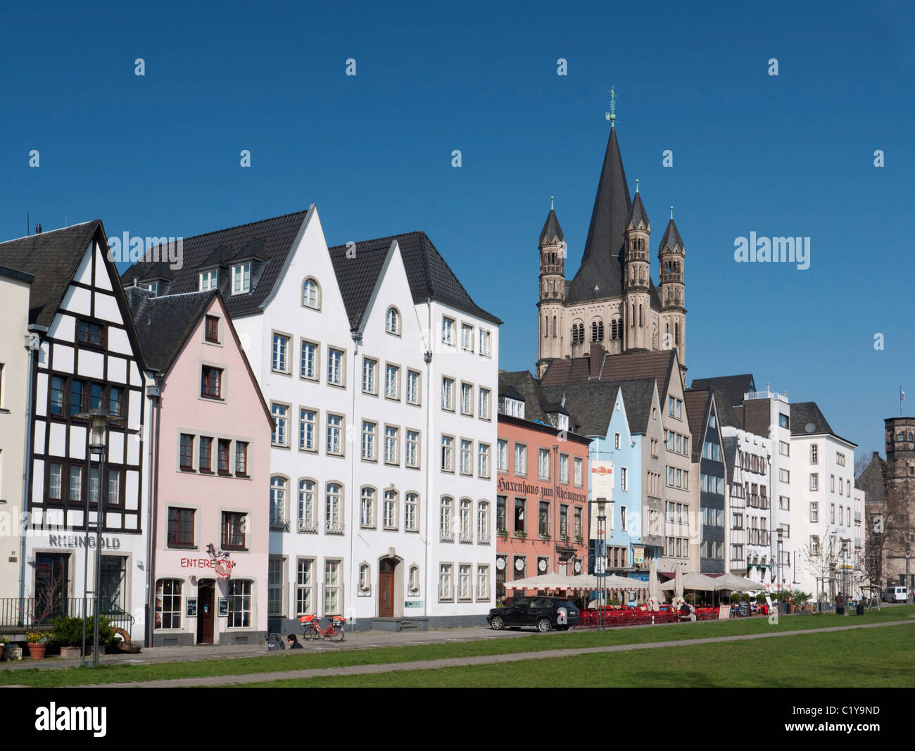 Historic style buildings and Gross St Martins Church in Altstadt or Old Town of Cologne beside the river Rhine Germany - Stock Image