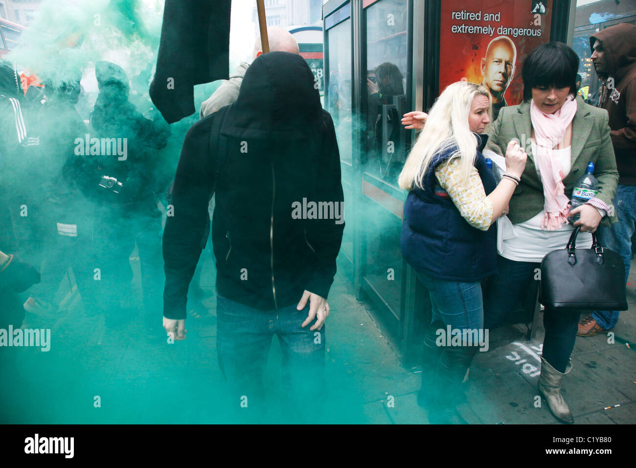 Anti capitalists / anarchists go on the rampage through central London on the back of the peaceful TUC protest march. - Stock Image