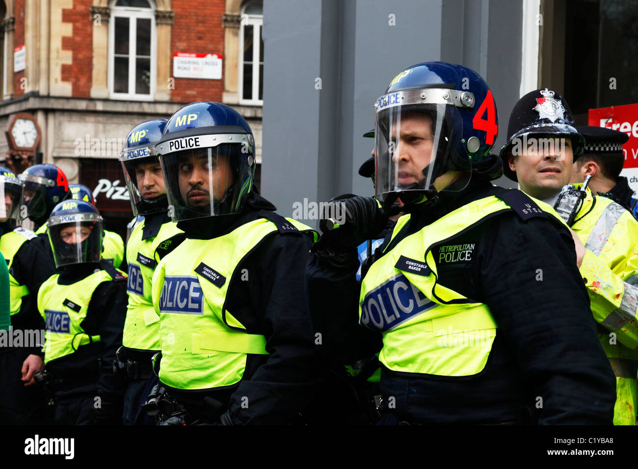 Riot police as anti capitalists rampage through central London on the back of the peaceful TUC protest march. - Stock Image