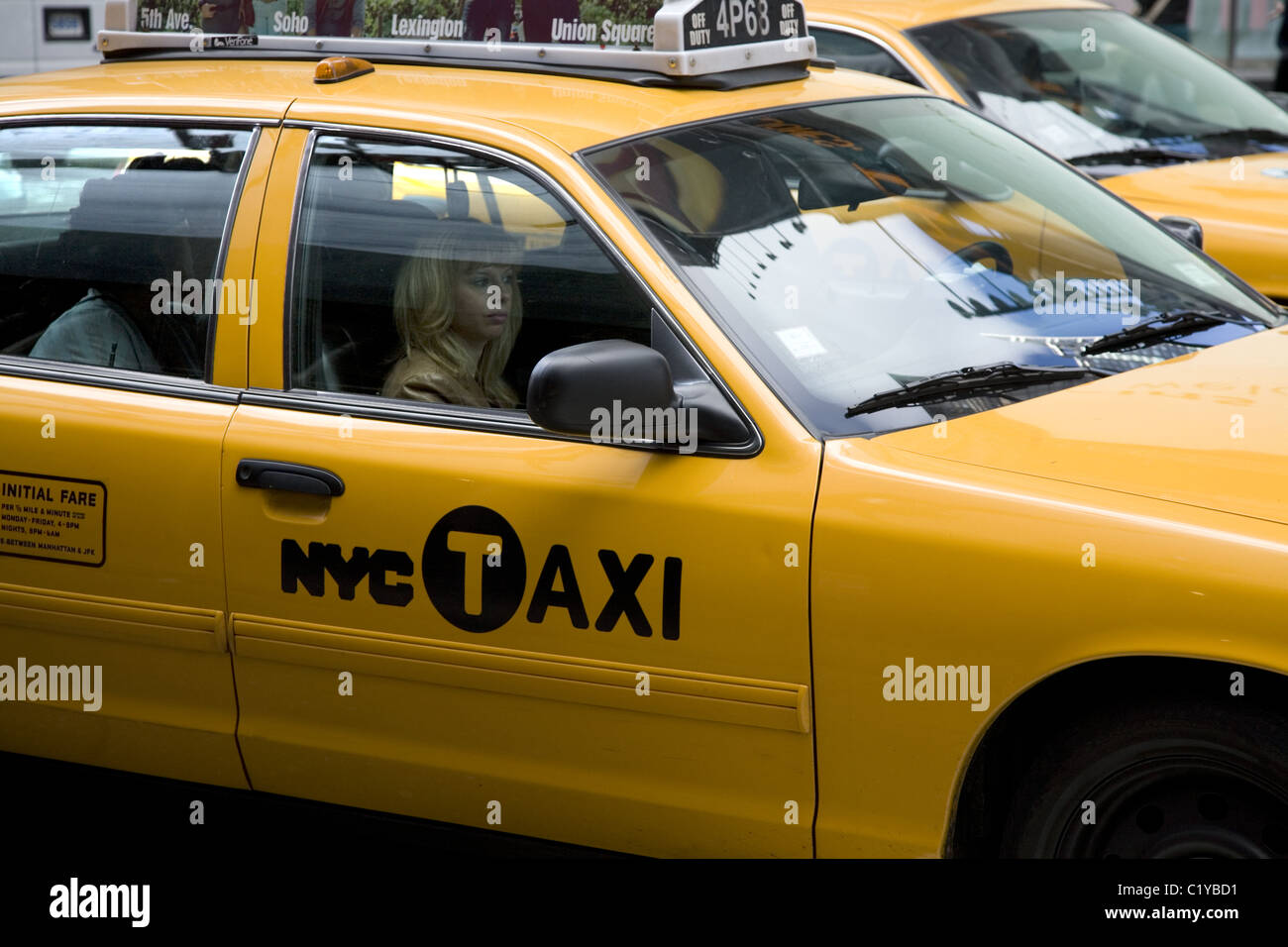New York City Taxicab in midtown Manhattan. - Stock Image
