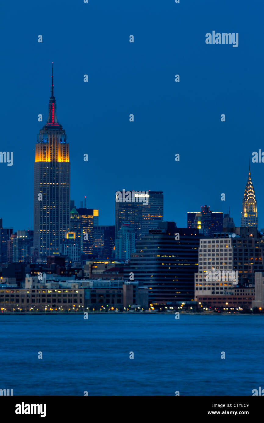 Empire State and Chrysler Buildings at night seen from New Jersey Stock Photo