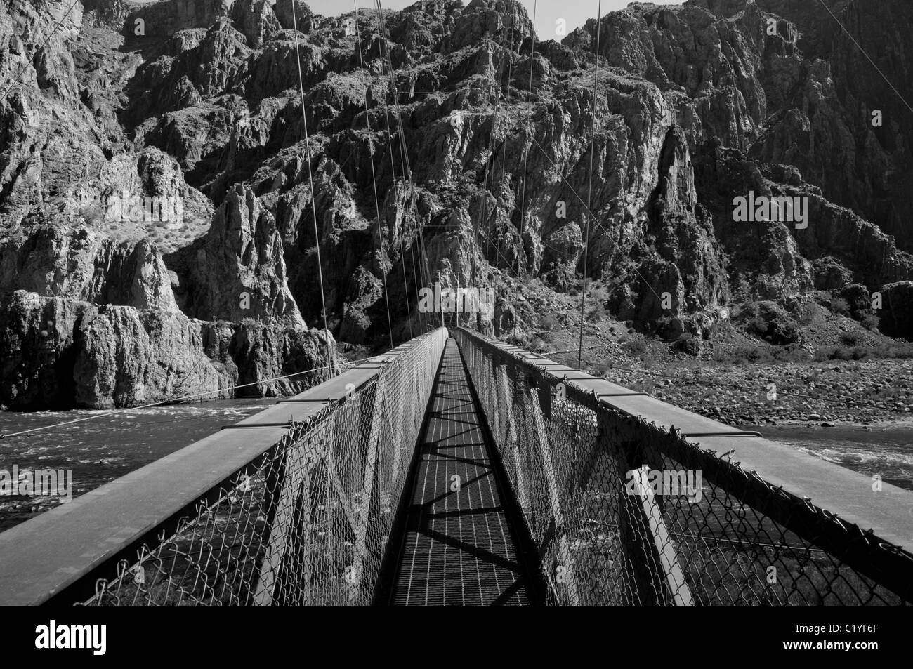 black and white bridge across Colorado River in Grand Canyon National Park - Stock Image