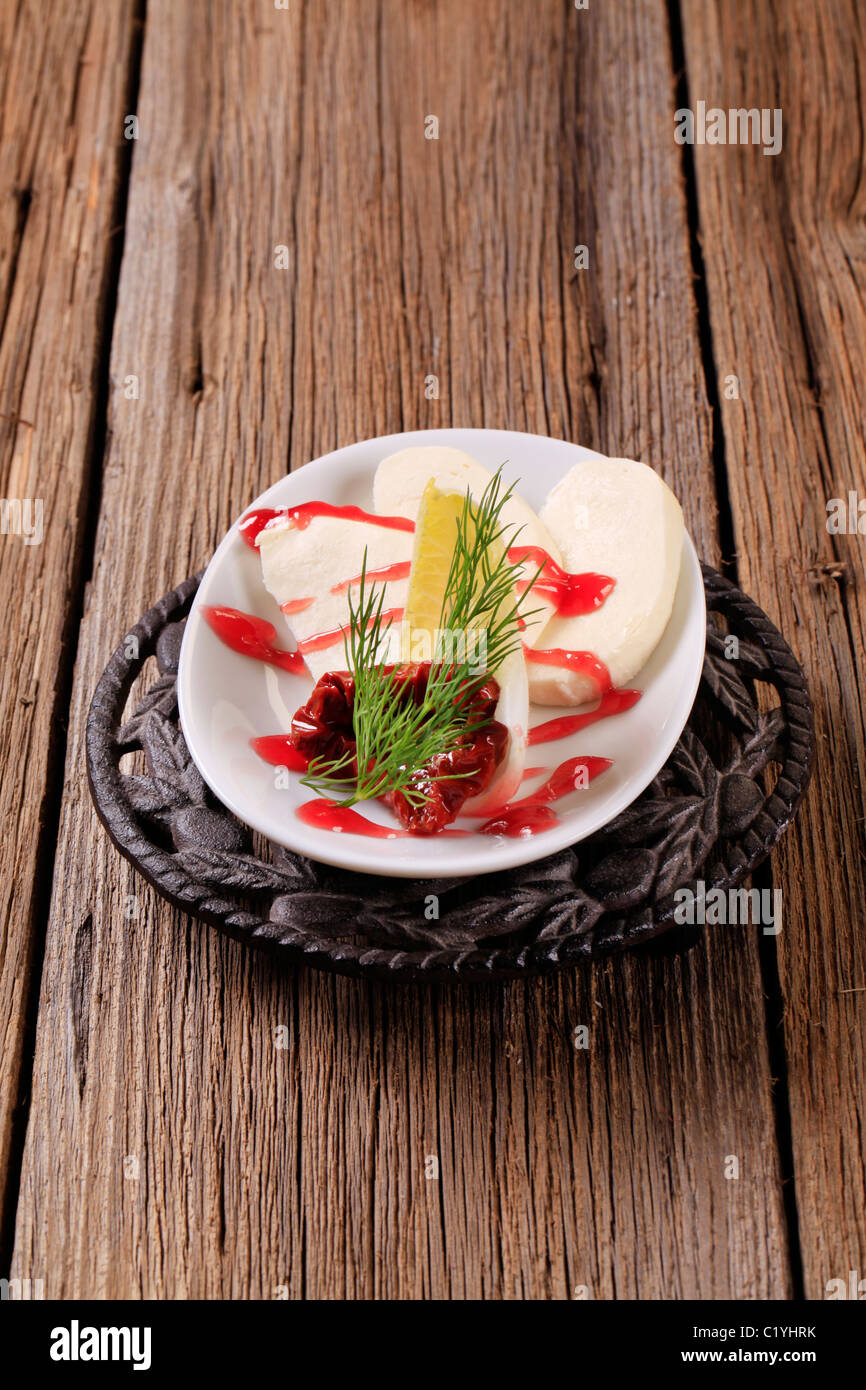 Mozzarella cheese with garnish and raspberry balsamic reduction - Stock Image