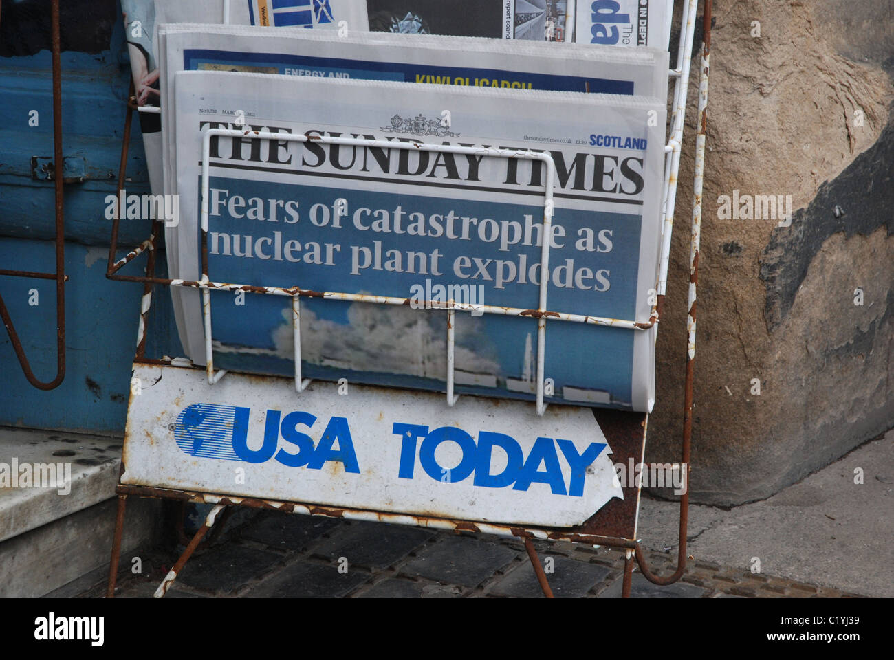 USA Today newspaper stand with a copy of the Sunday Times outside a newsagents in Edinburgh, Scotland, UK. - Stock Image