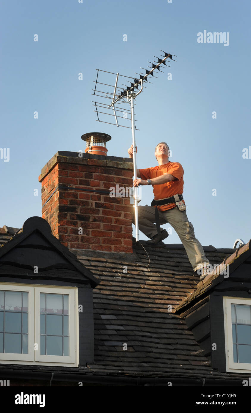 AERIAL FITTER FITTING NEW DIGITAL  TV AERIAL TO DOMESTIC HOUSE RE DIGITAL SWITCHOVER NEW AERIALS SIGNAL ANALOGUE - Stock Image