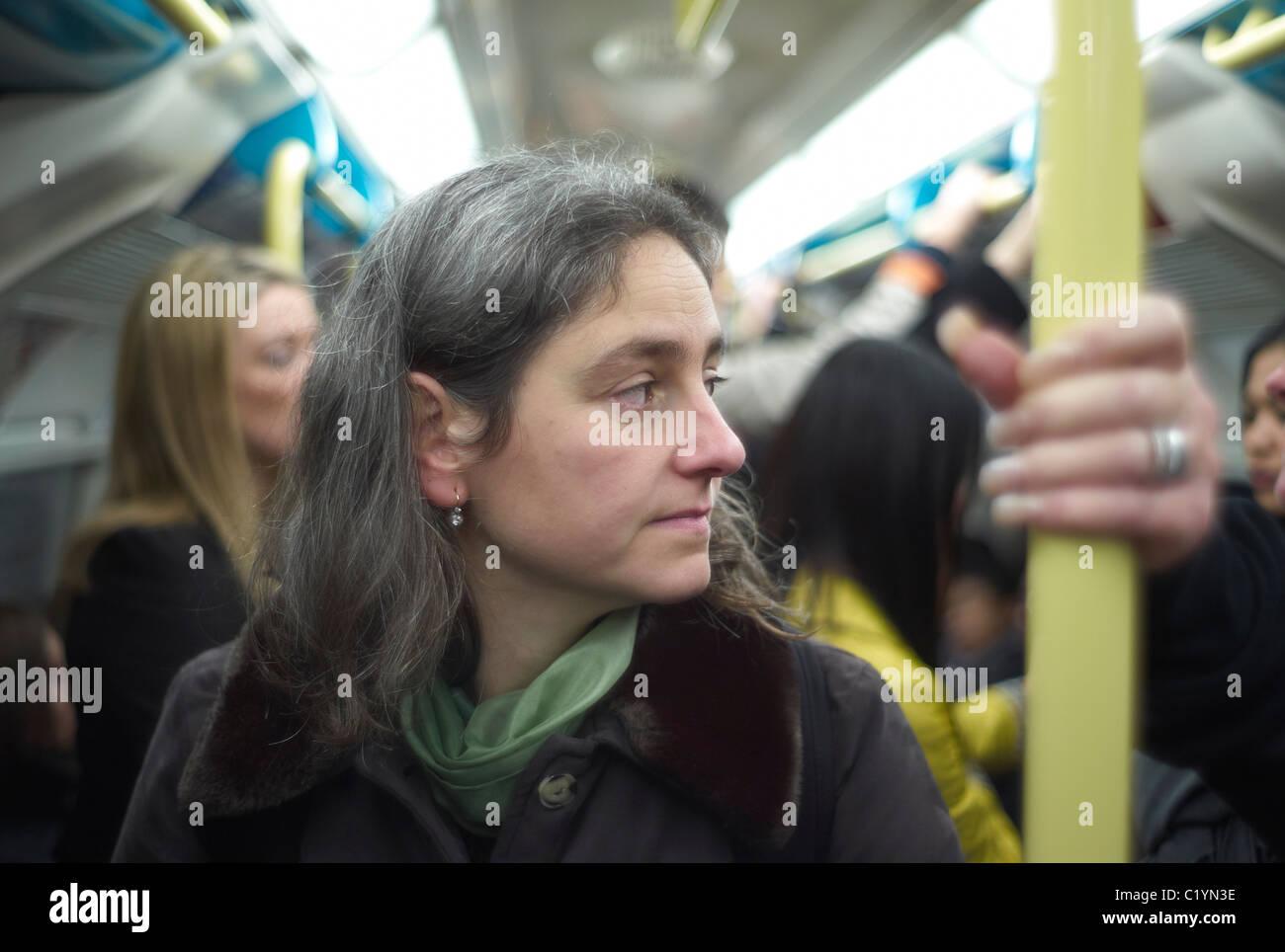 Woman on the London underground or Tube London England - Stock Image