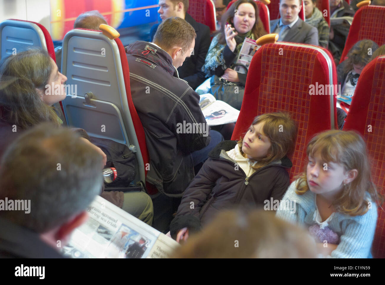 Passengers on a crowded South West Trains service from London Paddington to Reading and the SW of England - Stock Image