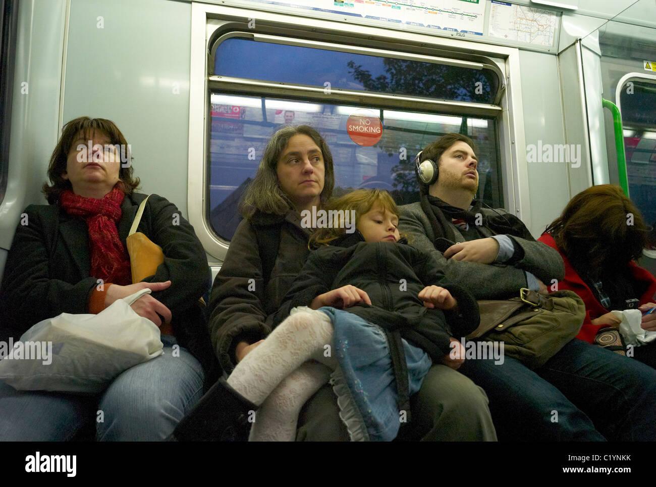 People on the London underground or Tube London England - Stock Image