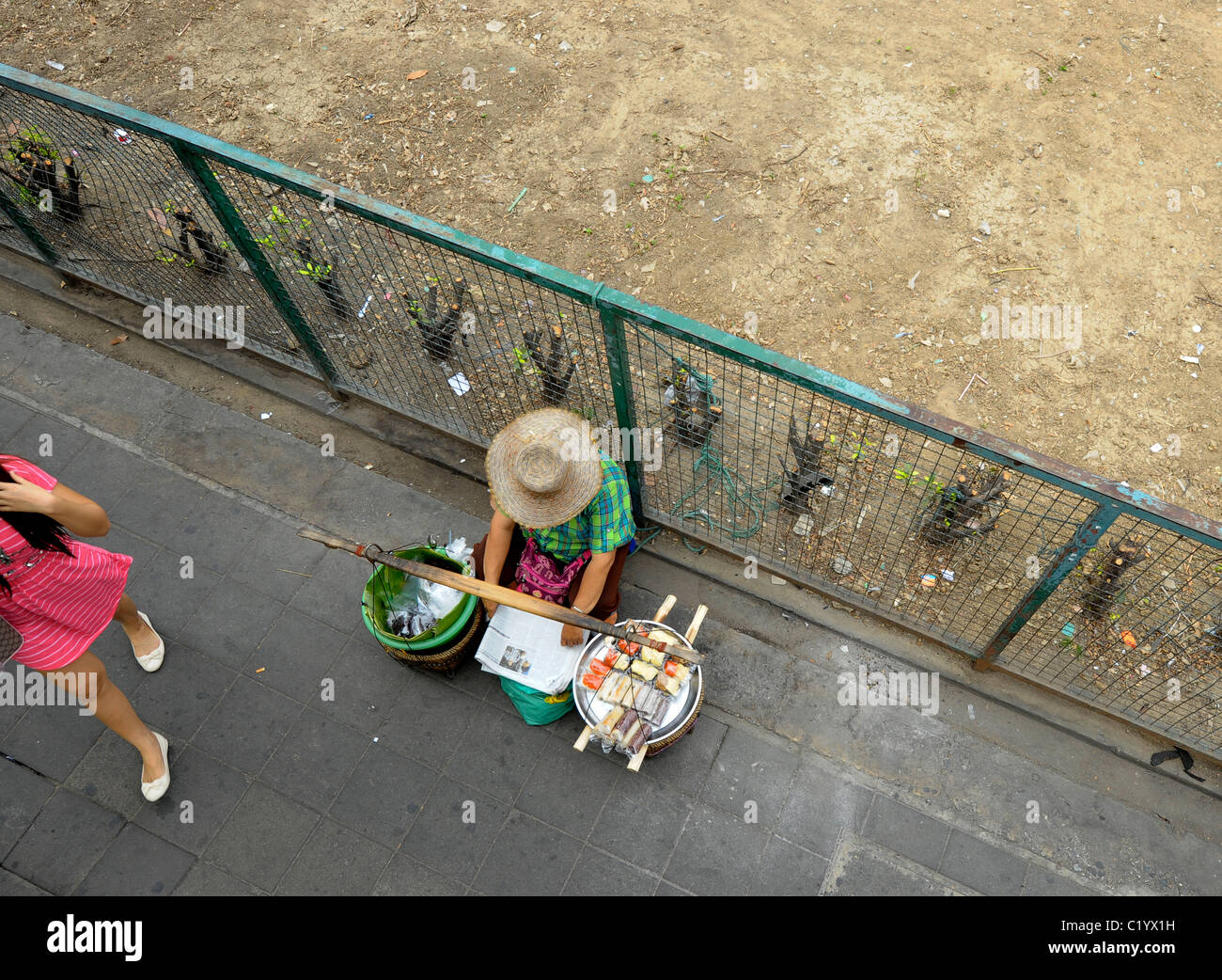 street hawker selling thai delicacy , street life , everyday living , bangkok, thailand - Stock Image