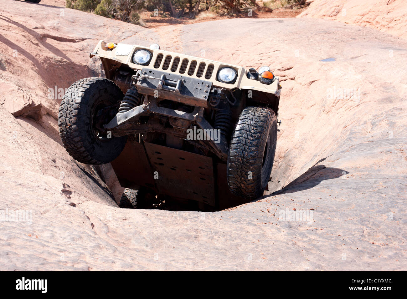 HUMMER using its full potential on the famed sandstone slick rock of Moab, Grand County, Utah, USA. - Stock Image