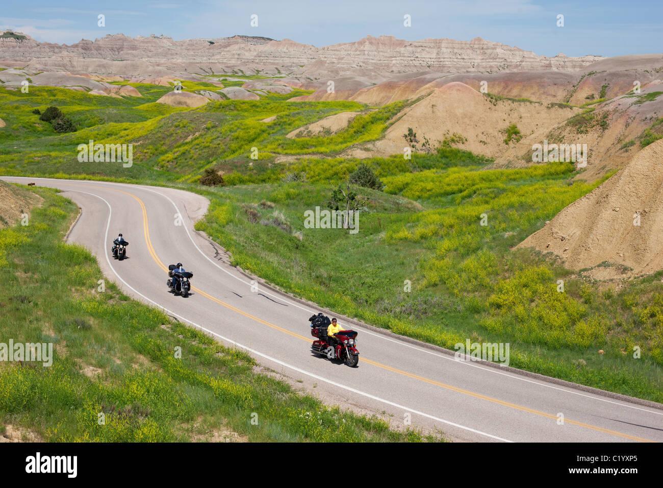 MOTORCYCLISTS riding their Harley-Davidson in Badlands National Park, South Dakota, USA. - Stock Image