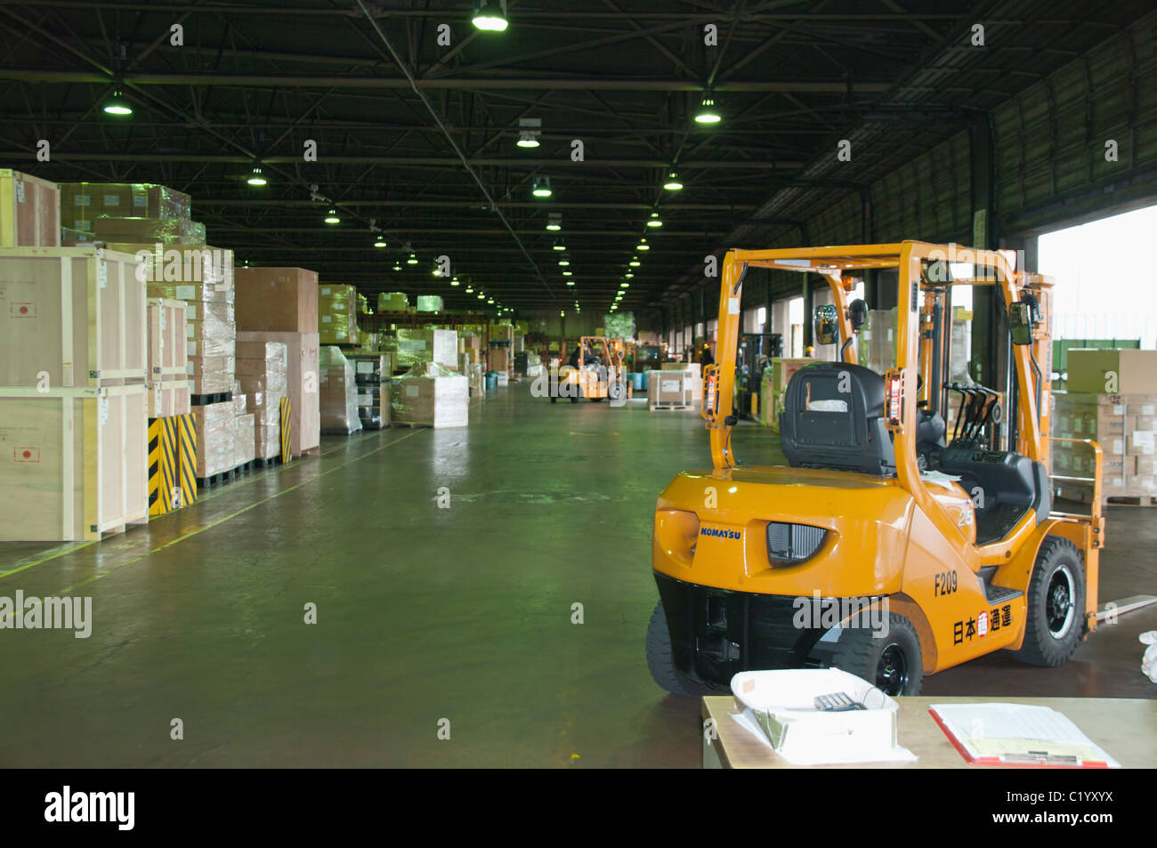 truck loader forklift with full load on pallet in a warehouse in japan company - Stock Image