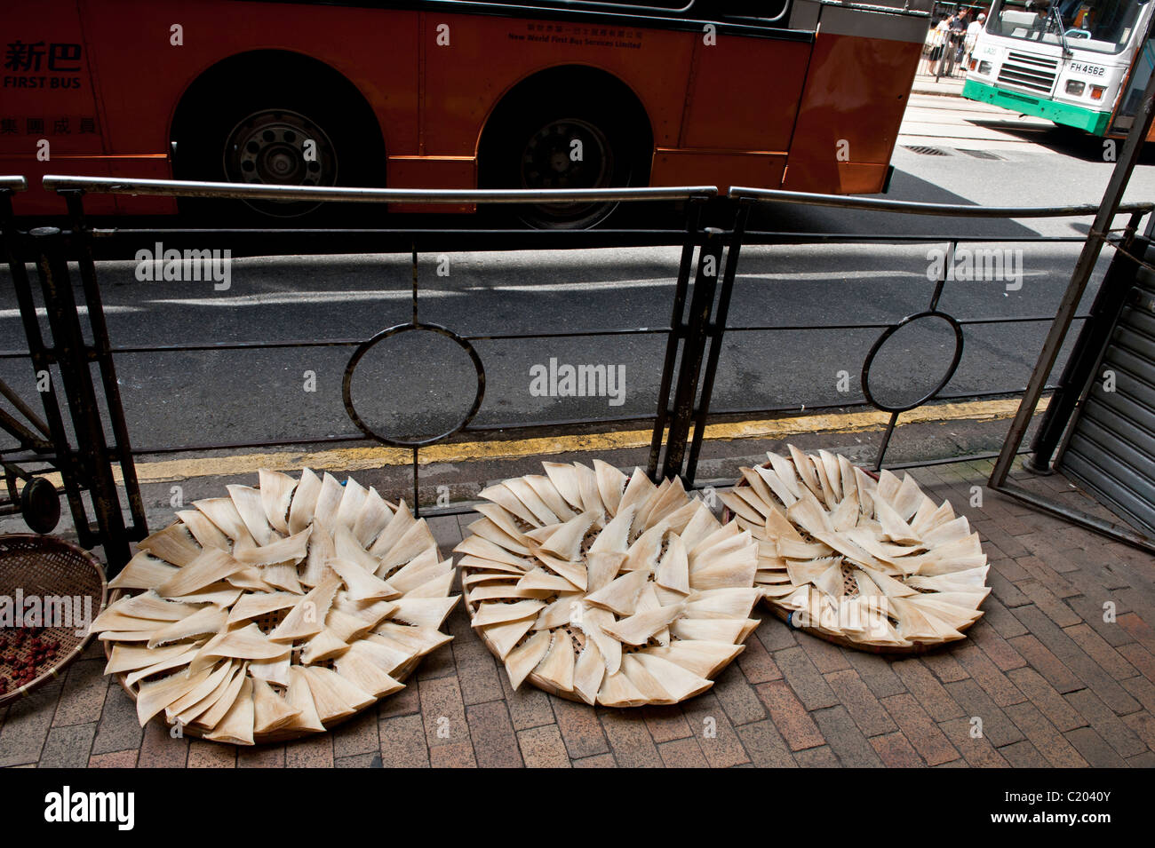 China, Hong Kong, Shark fin drying in one of the main streets of the centre of the city. - Stock Image