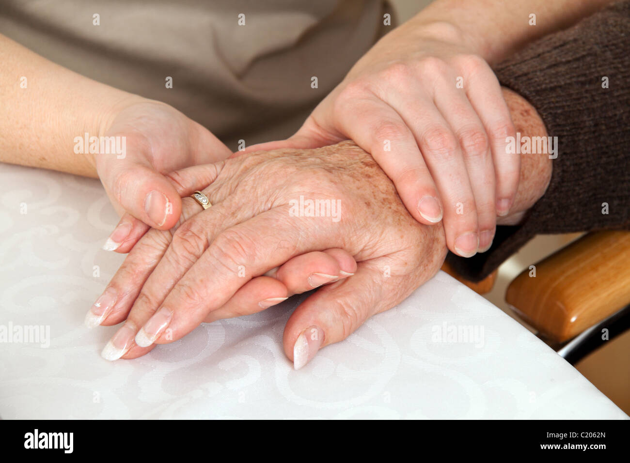 Woman comforting a widow after death. Bereavement support. Stock Photo