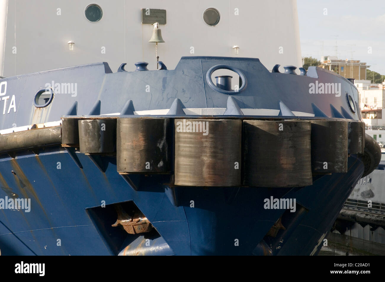 tug boat boats tugs tugboat tugboats rubber bumper bumpers nudge push force forces newton maneuver maneuvering harbour - Stock Image