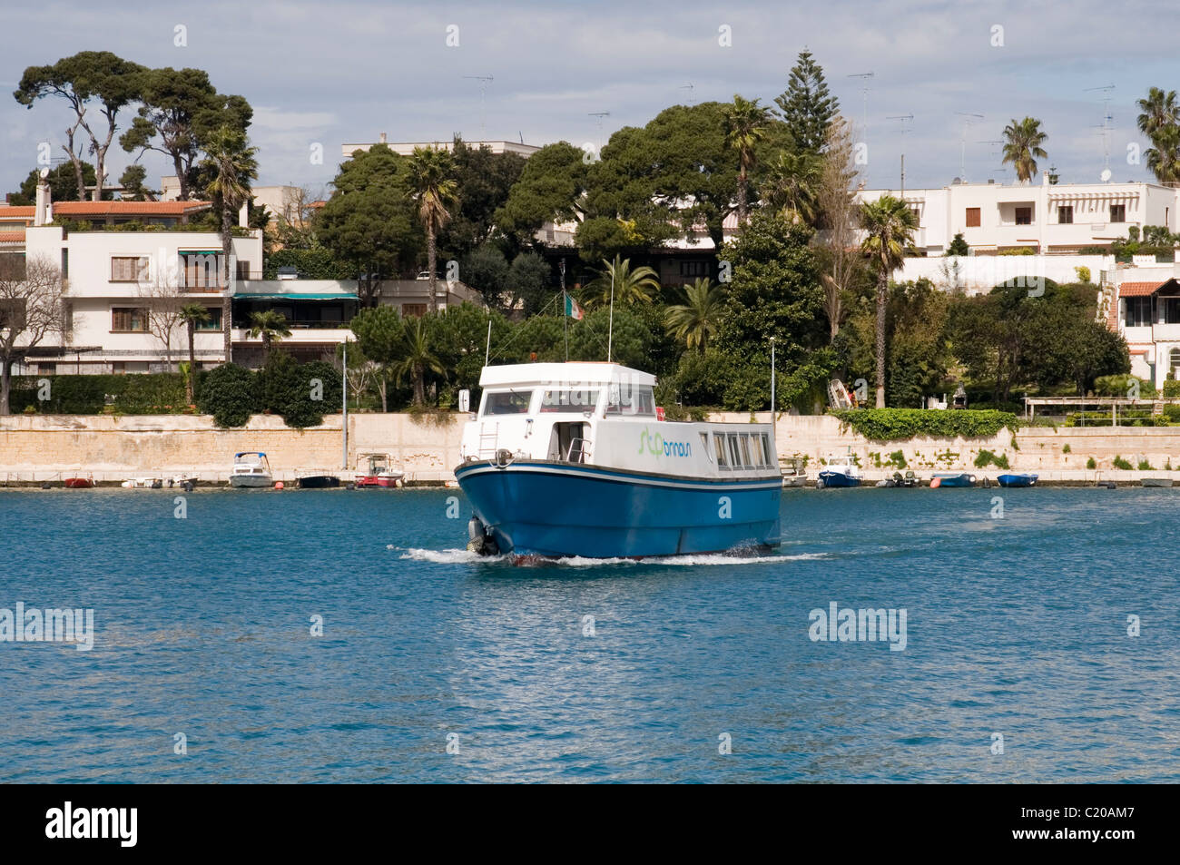 water bus taxi boat trip ride across the water brindisi harbour italy public transport ferry ferries passenger foot Stock Photo