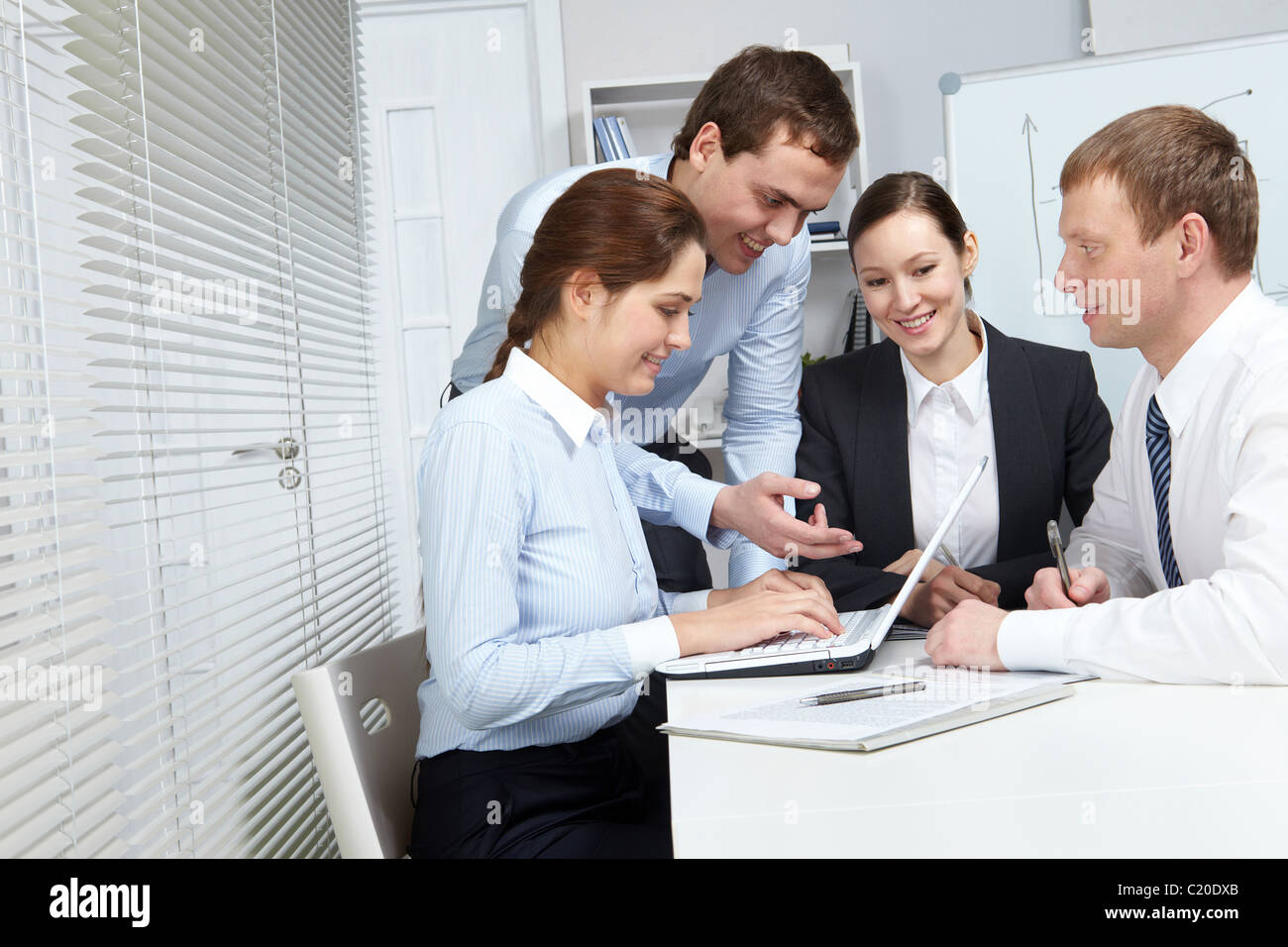 Four business people making their everyday work - Stock Image
