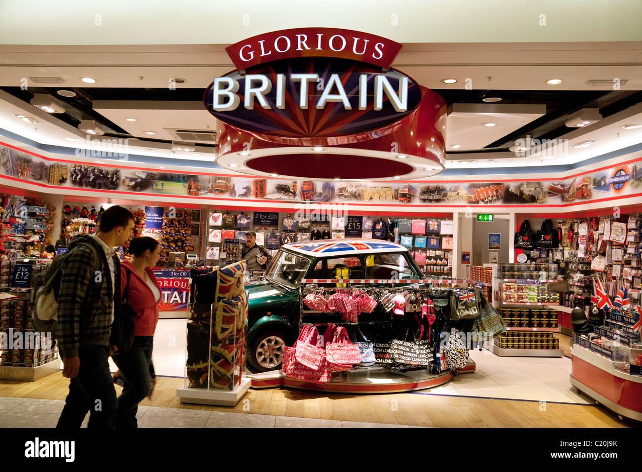 People at the 'Glorious Britain' souvenir shop, Terminal 5, heathrow airport London UK - Stock Image