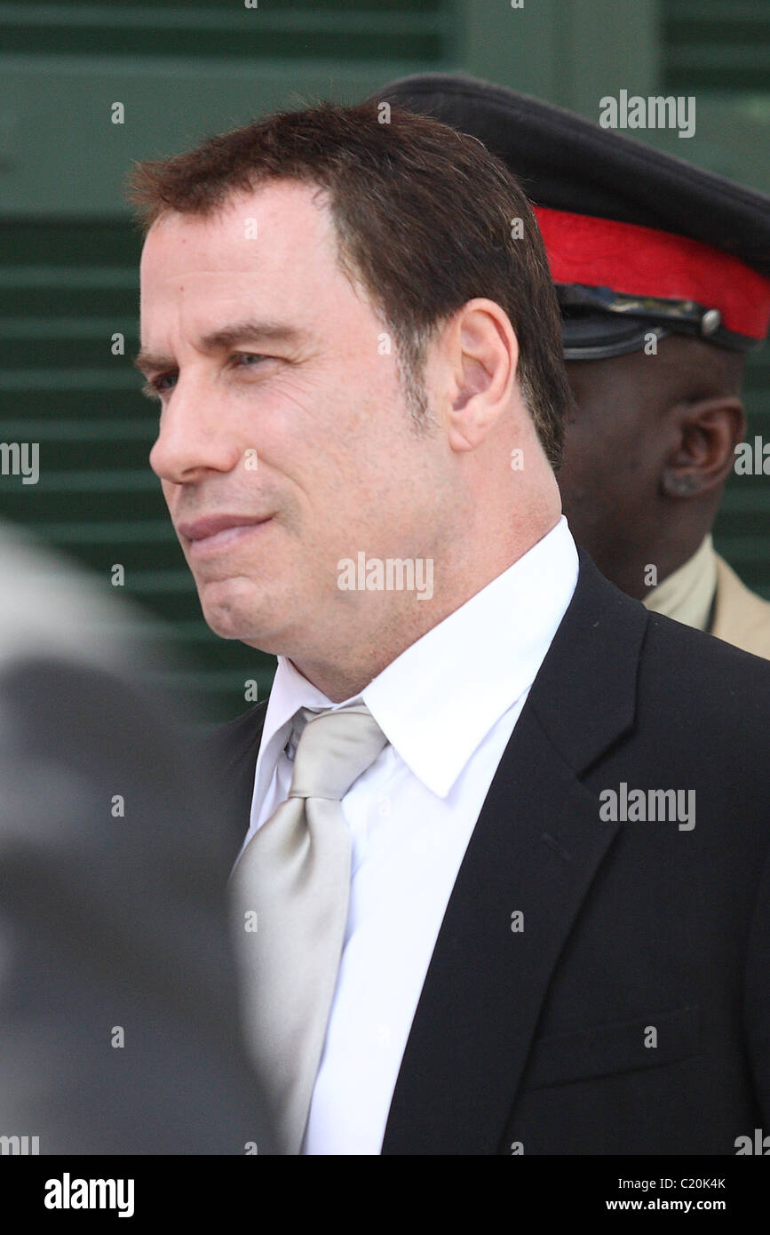 John Travolta leaves the Supreme Court, after the extortion