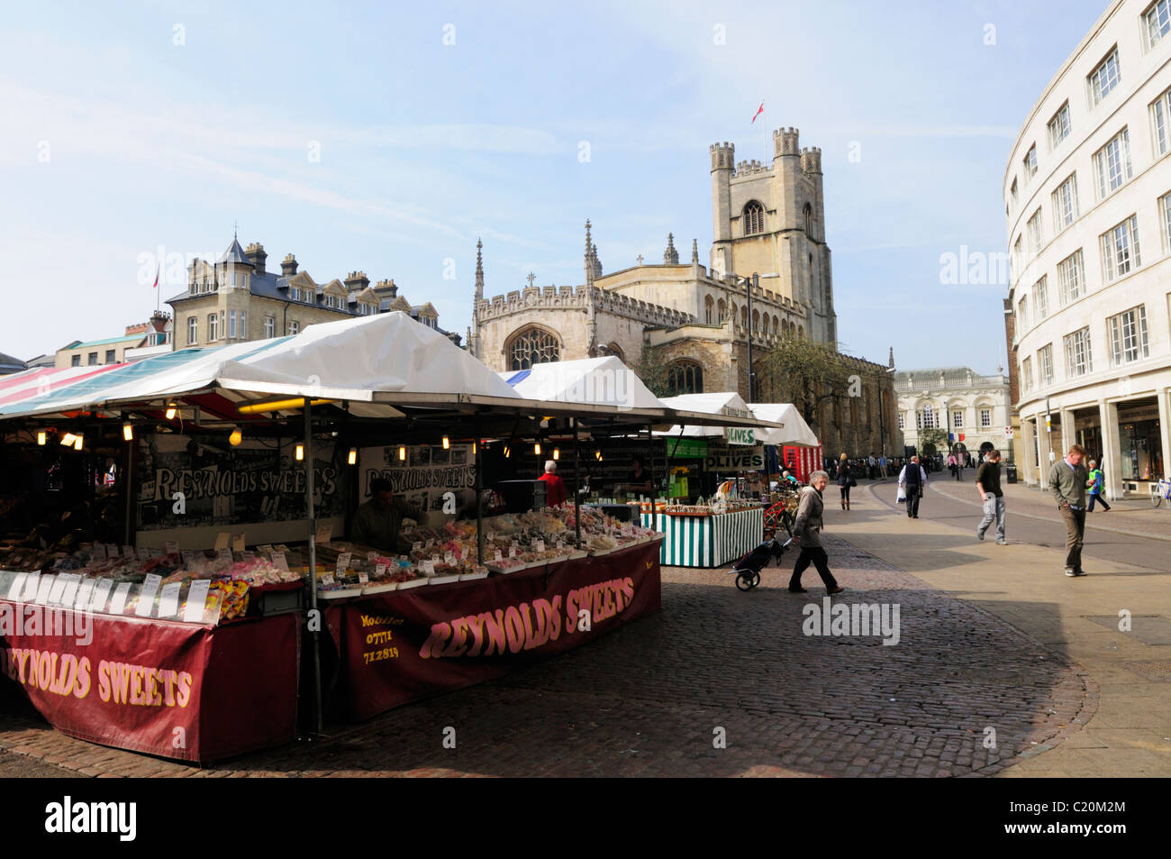 Reynolds Sweets Stall on The Market, with Great St Marys Church, Cambridge, England, UK - Stock Image