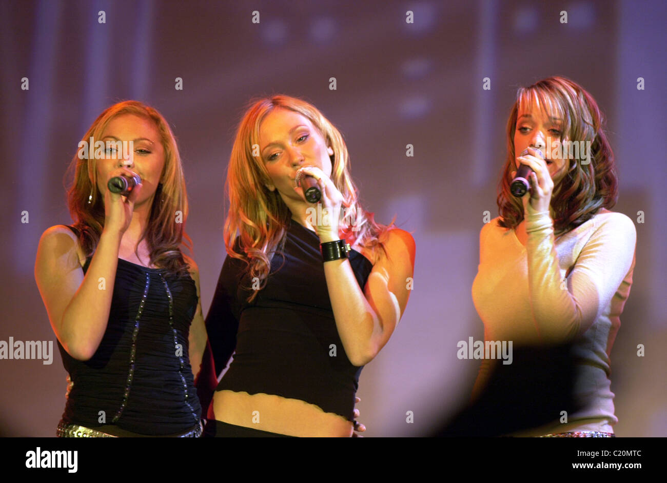 Atomic Kitten Natasha Hamilton, Liz McClarnon, and Jenny Frost in 2003 - Stock Image
