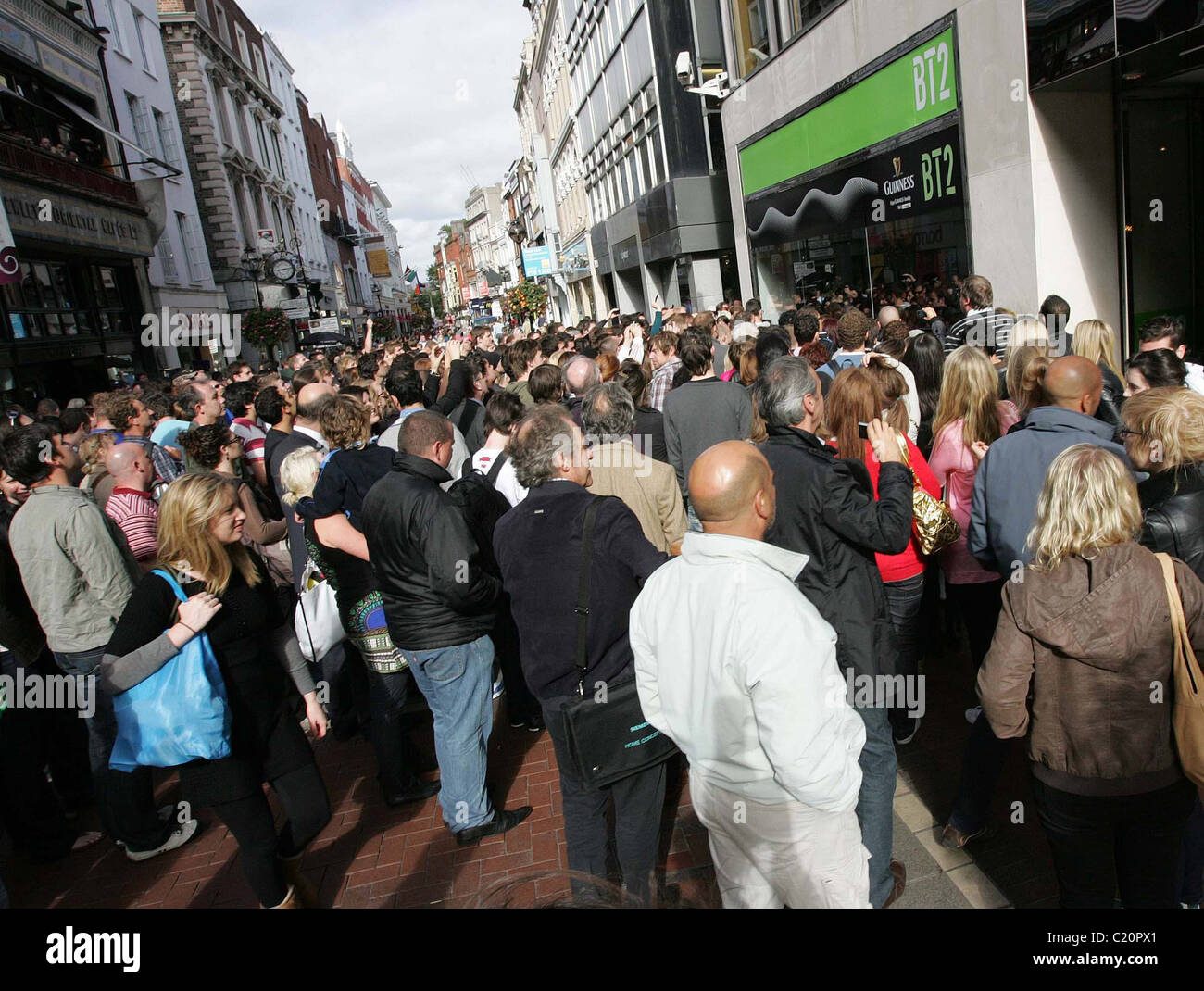 Crowds watching Ronnie Wood playing with his son Jesse's band 'Black Swan' at BT2 in Grafton Street - Stock Image