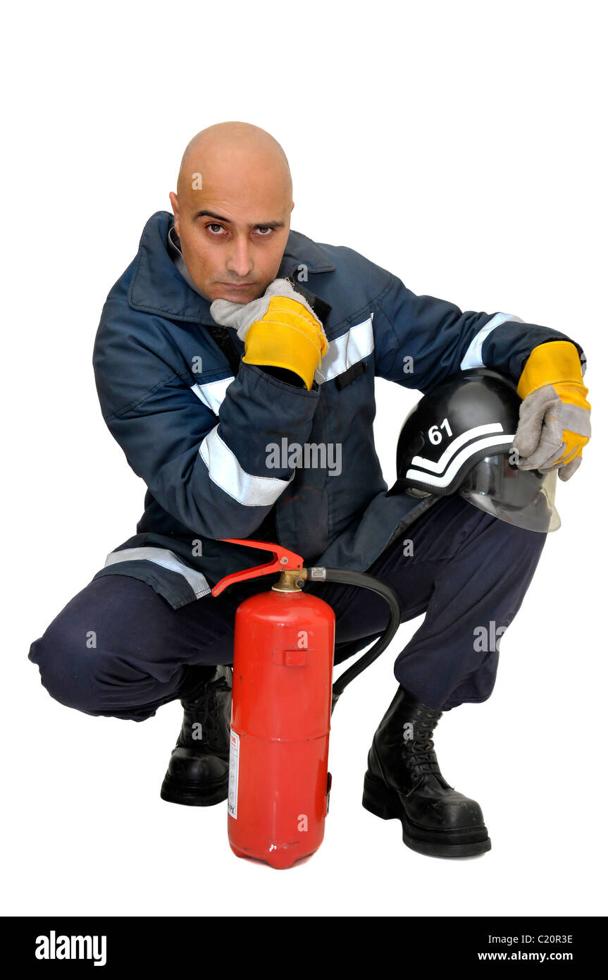 Fireman with extinguisher isolated in white Stock Photo