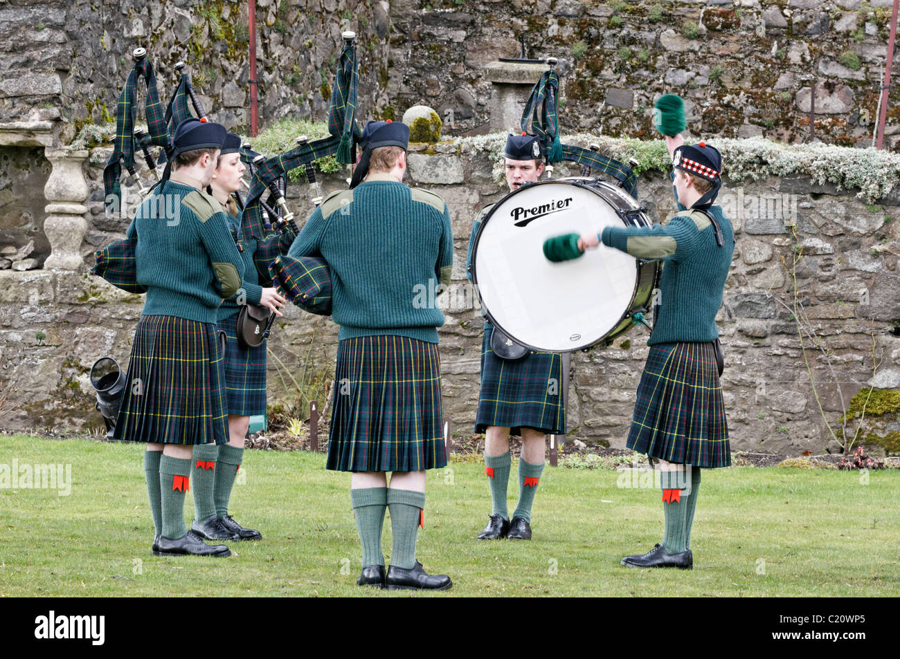 Members of the British Army's Officer Training Corps (OTC) playing in a Pipes and Drums Band competition - Stock Image