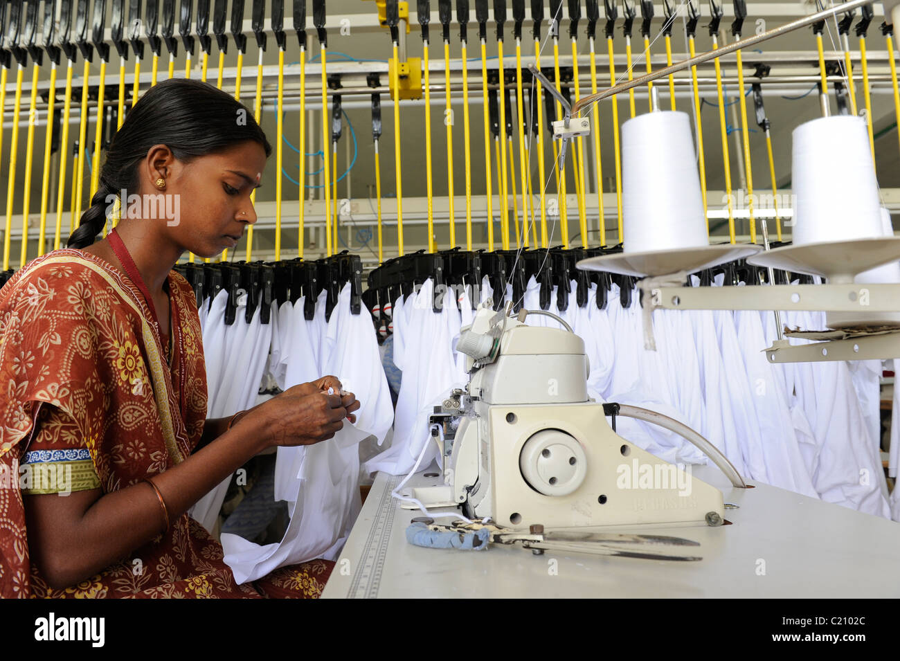 India, Tamil Nadu, Tirupur , women work in fair trade textile factory, production of garments and apparels for export - Stock Image