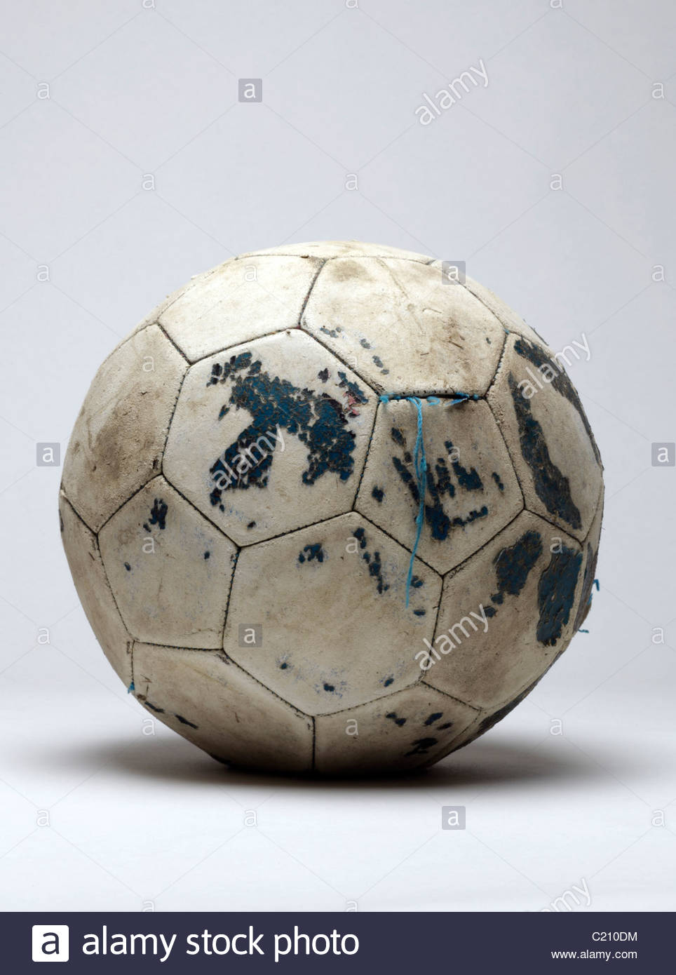 old dilapidated leather football - Stock Image