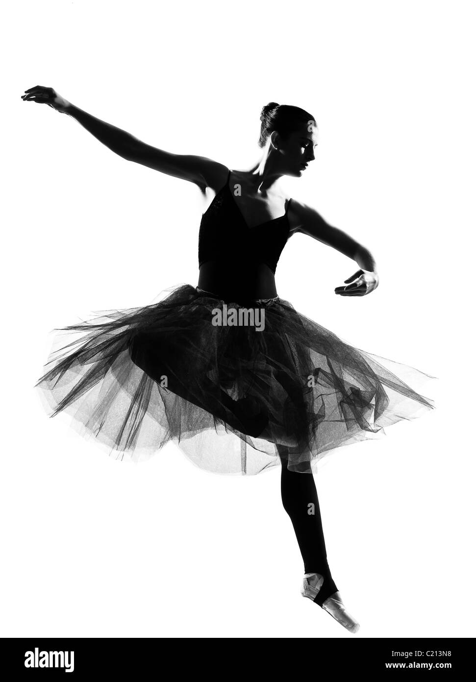 one beautiful caucasian woman ballet dancer dancing leap jumping full length on studio isolated white background - Stock Image
