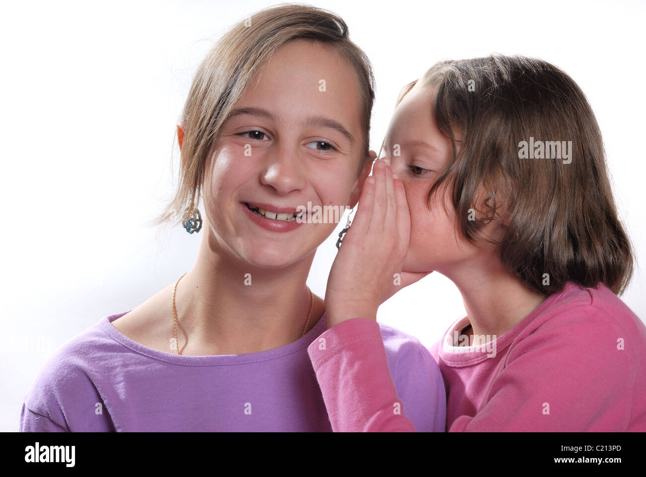 complicity between sisters - Stock Image