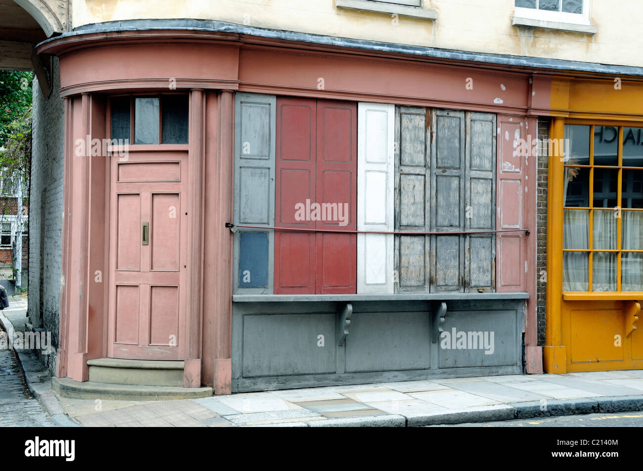 Georgian shop with shuttered windows and rounded front door Bermondsey Street London England UK - Stock Image