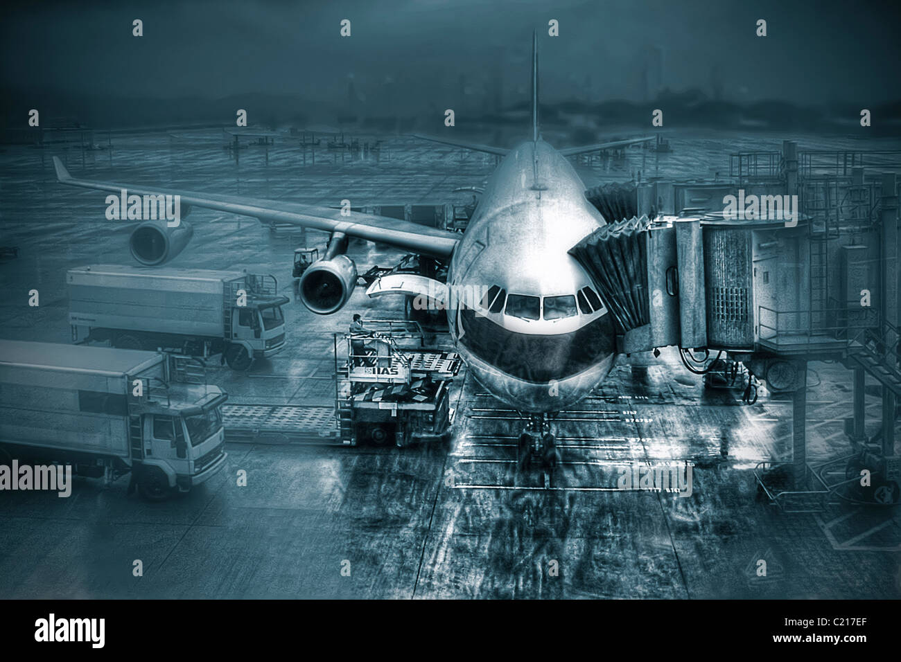 Boeing 757 commercial airliner at boarding gate at Hong Kong International Airport - Stock Image
