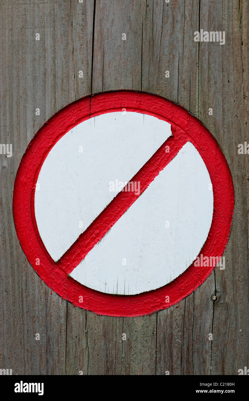 Painted Red and white no entry sign carved into wood - Stock Image
