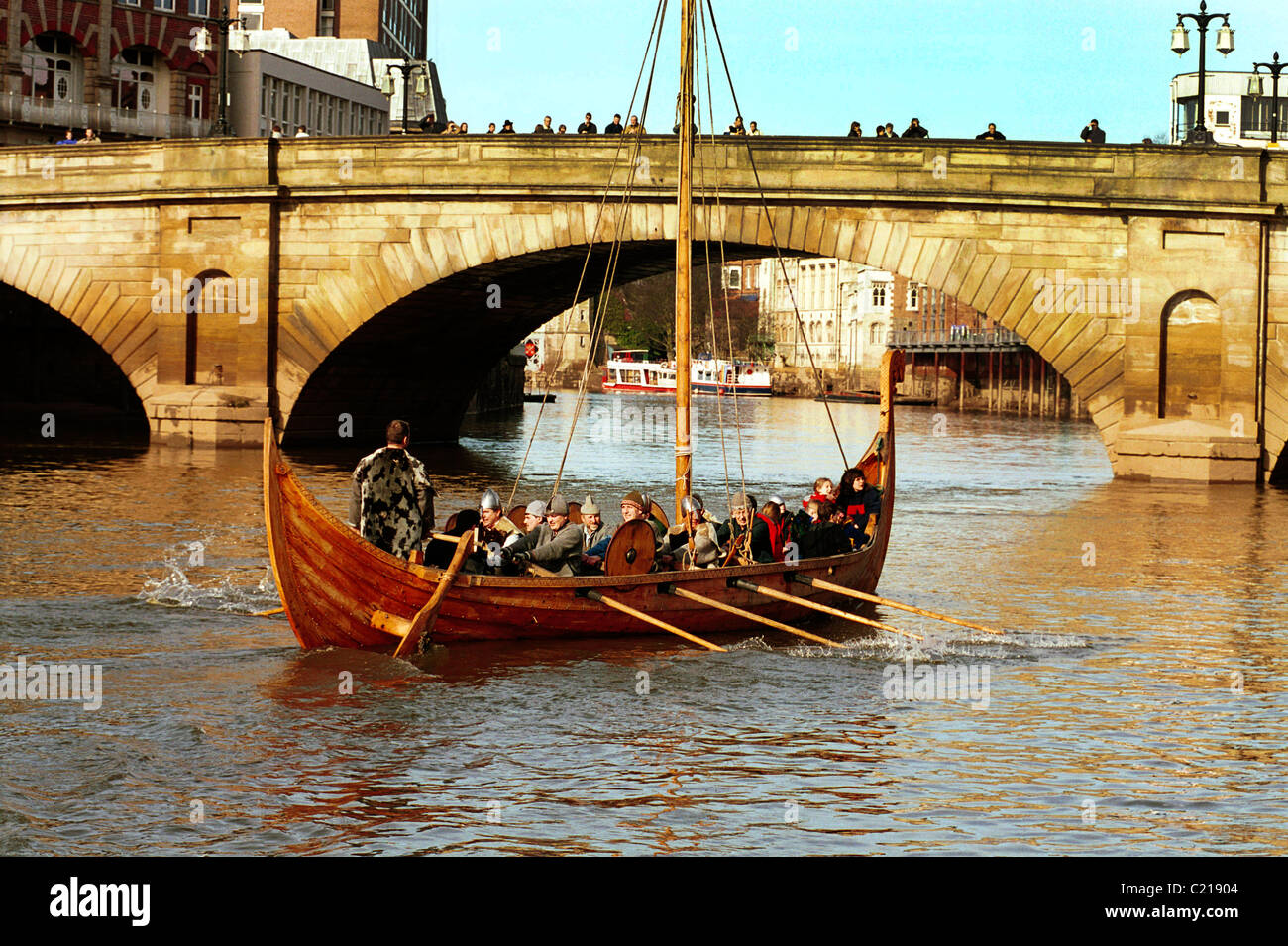 A replica viking longboat on the River Ouse at York, UK. - Stock Image